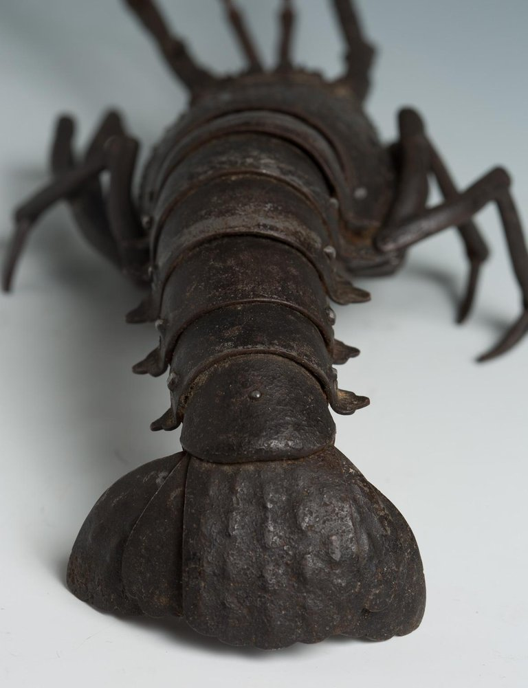 Japanese Articulated Iron Jizai Okimono of a Lobster by Myochin Muneharu from roughly 1850 Dimensions - H 3.55 in. x W 16.34 in. x D 3.55 in.H 9 cm x W 41.5 cm x D 9 cm  (image - 1stDibs)