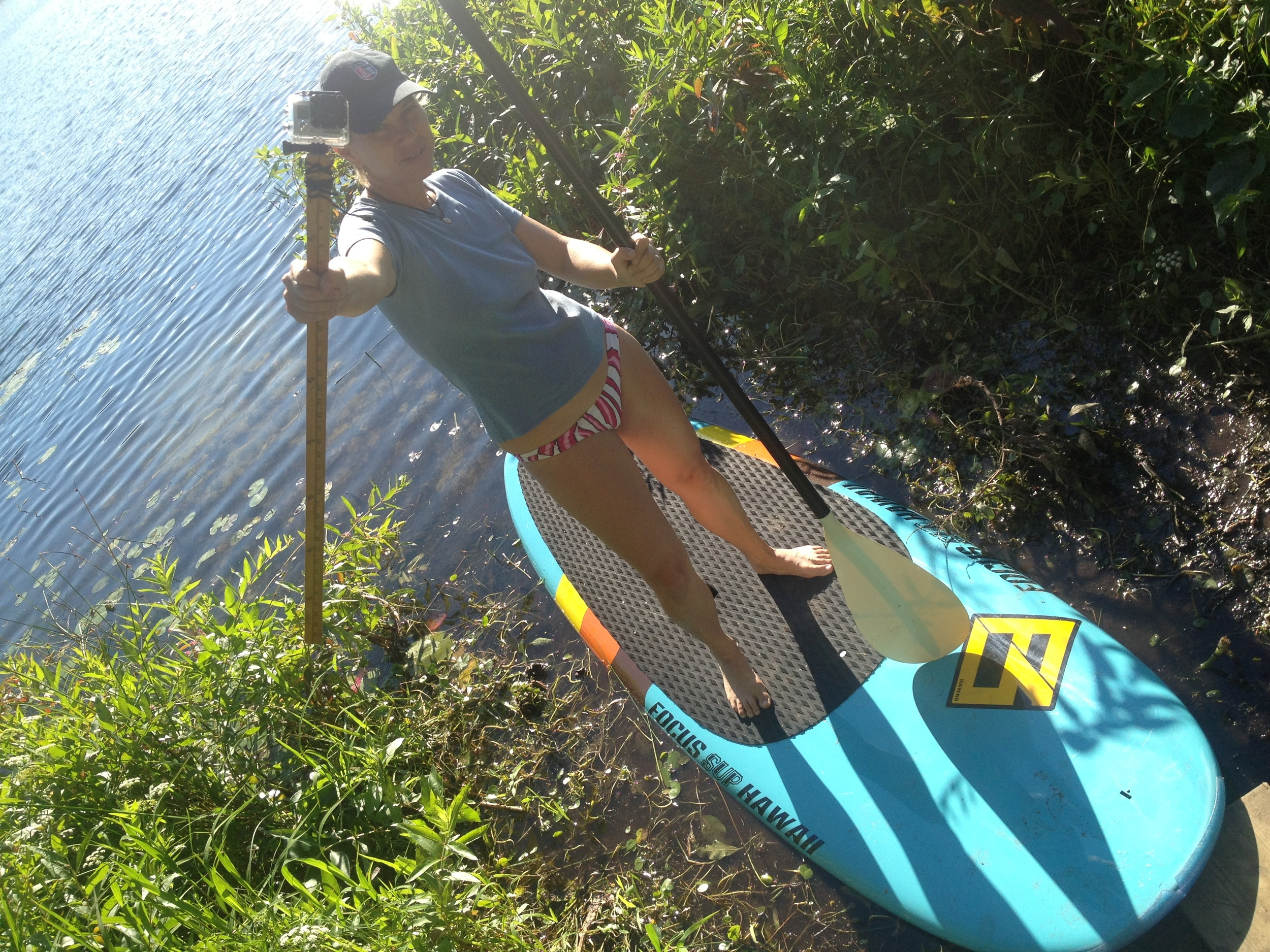 Madeleine on paddle board with Go Pro on a stick for Crystal Lake shoot