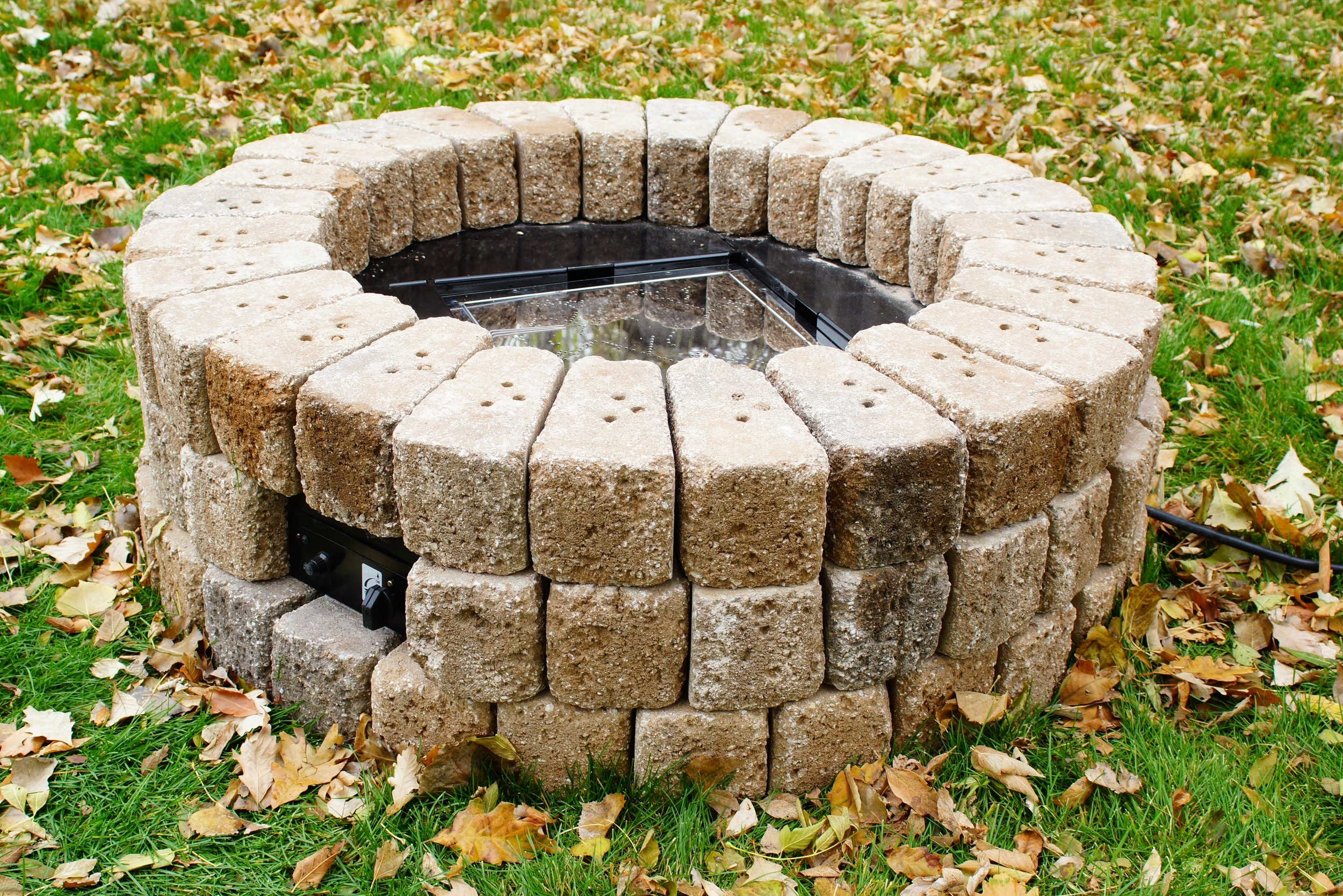 9. Let concrete adhesive cure. Add Lava Rock until burner area is covered with approximately 2 inches of rock.