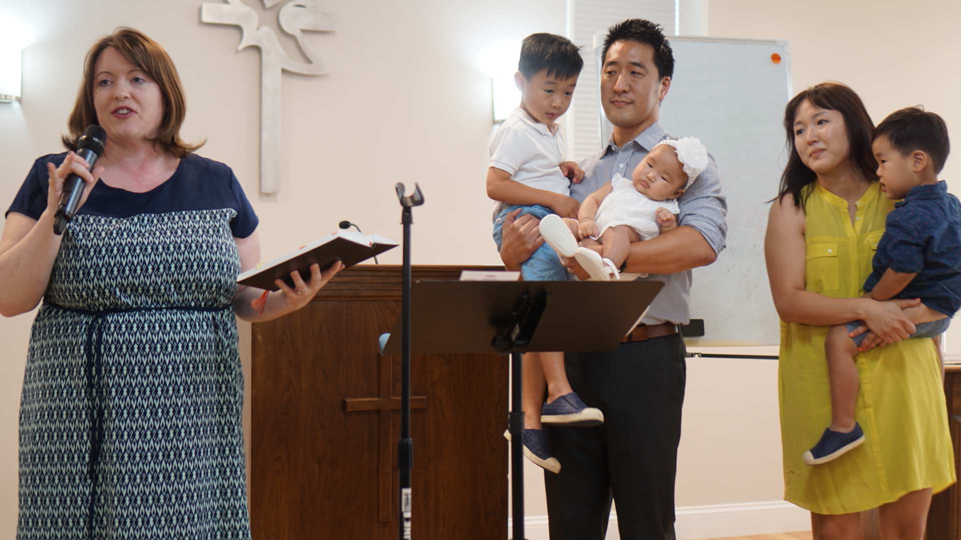 Baby Ellie being dedicated by Pastor Devyn from Community Covenant Church