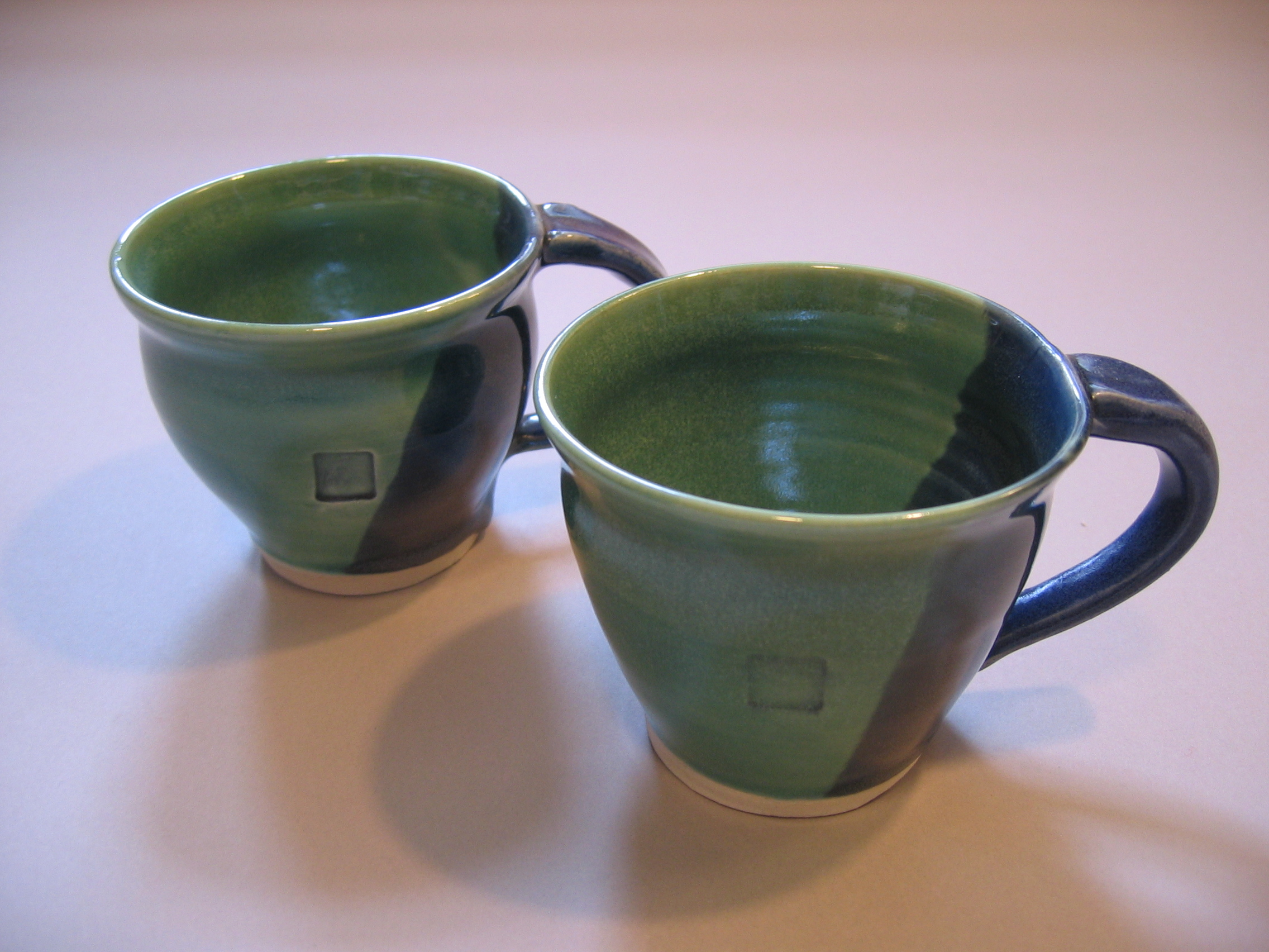2 Blue green mugs $16 each