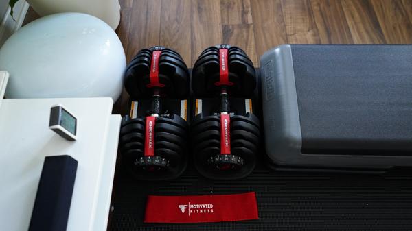 home gym ideas for women adjustable dumbbells