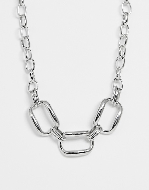 high-waisted-skirts-silver-chain-necklace.jpeg