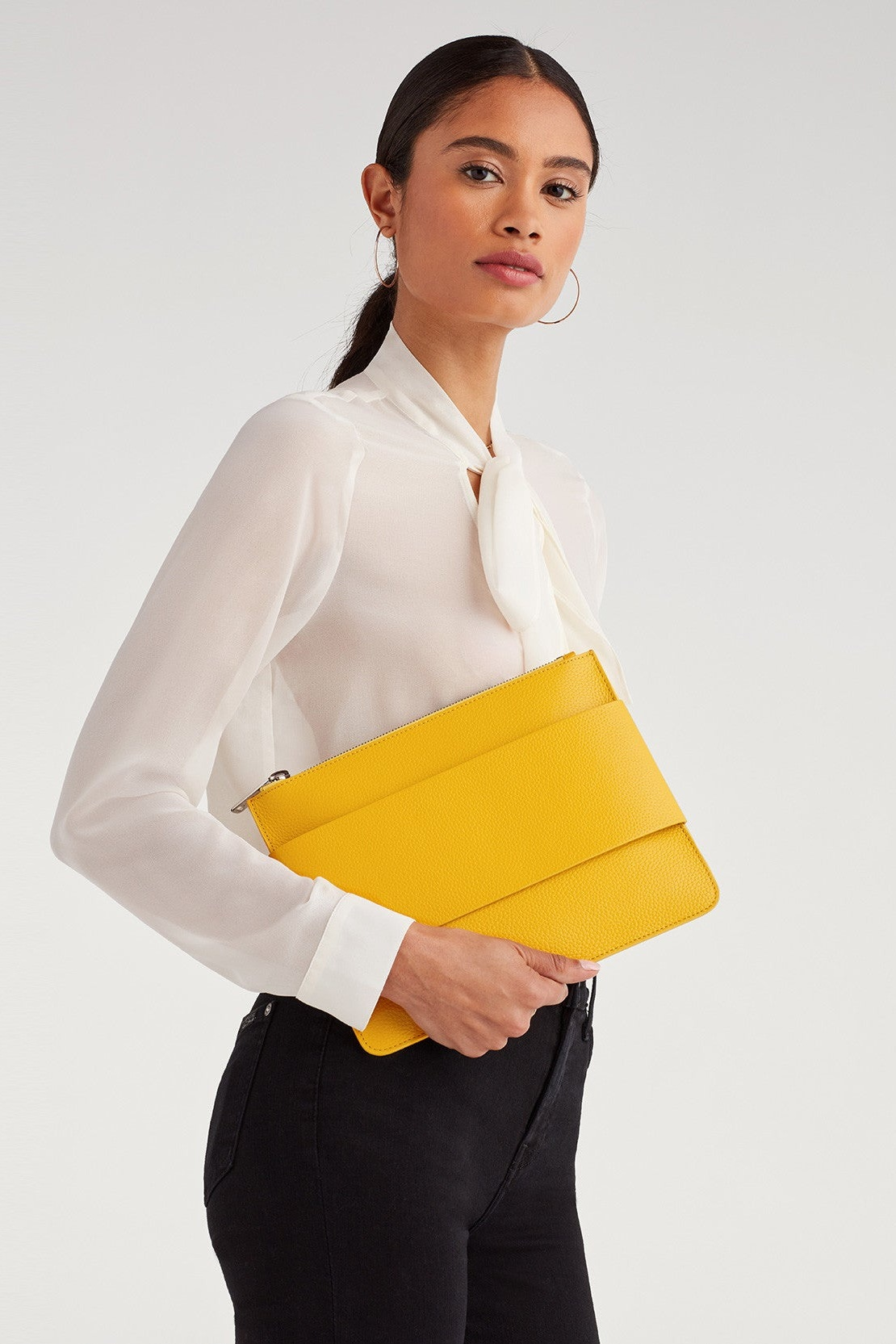 Mankind Clutch in Yellow, $57, 7 For All Mankind