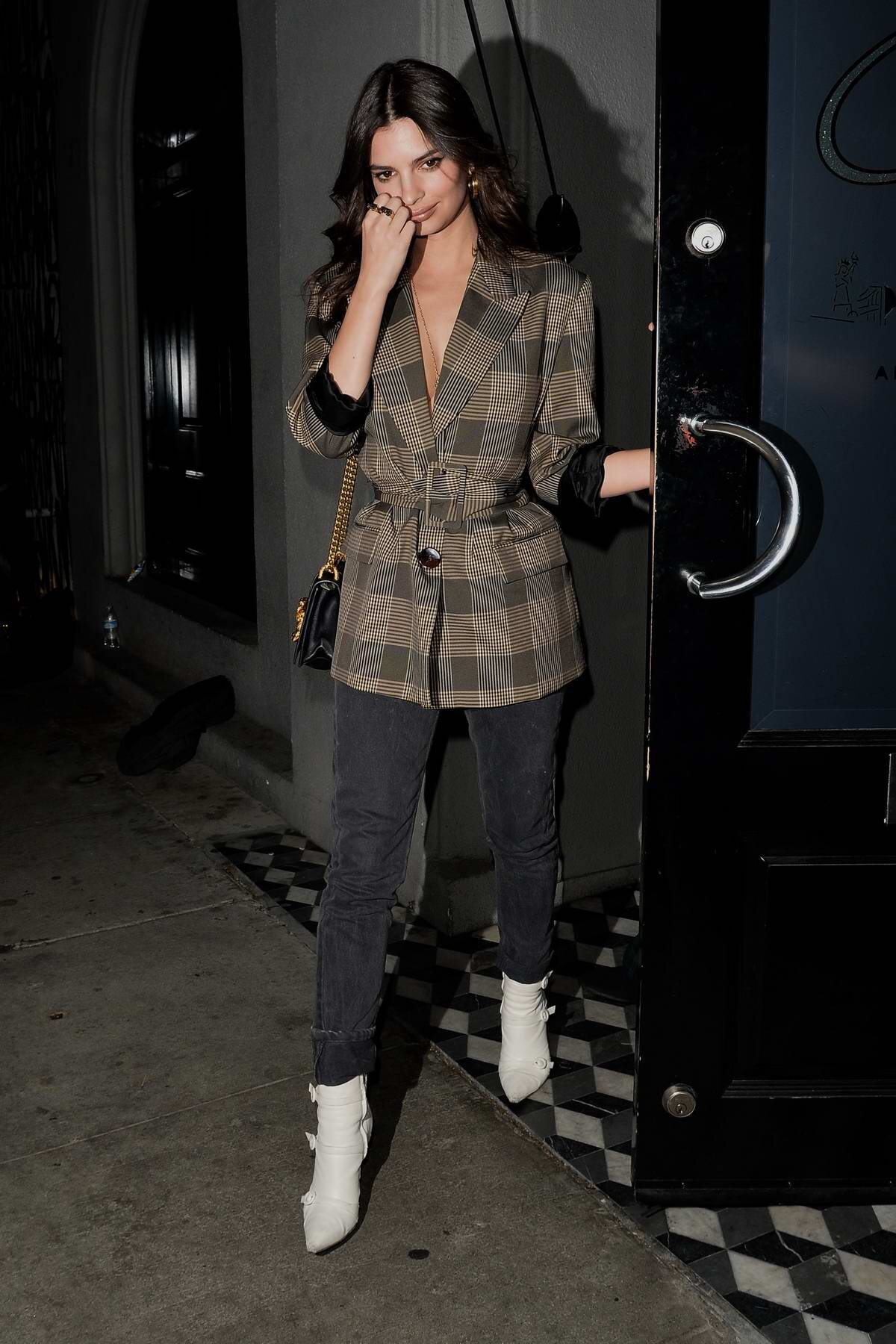how-to-wear-black-jeans-emily-ratajkowski-wears-plaid-jacket-with-black-jeans.jpg