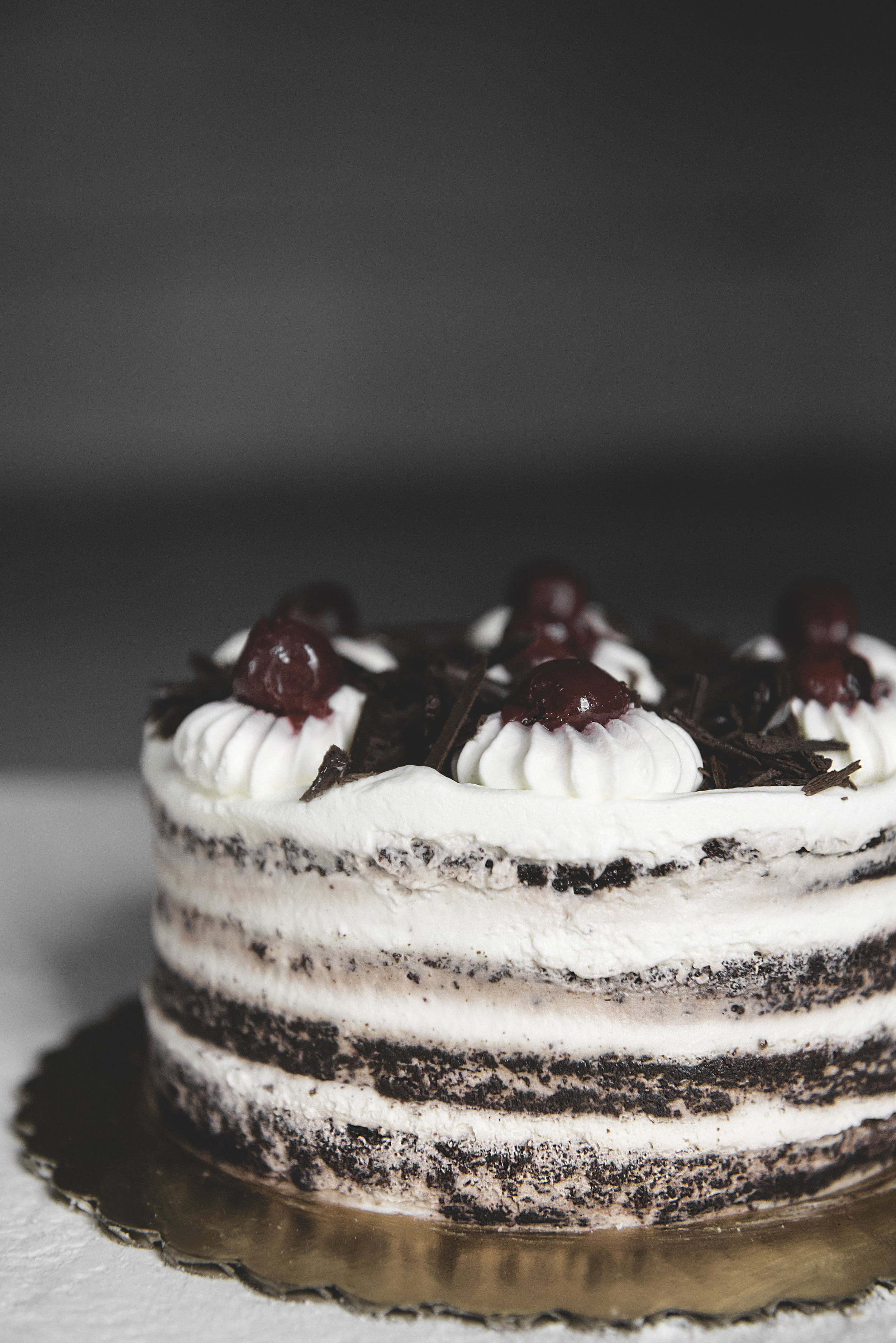 Black Forest Cake - Get lost in a classic. Rich chocolate cake, kirsch cream, & candied cherries.