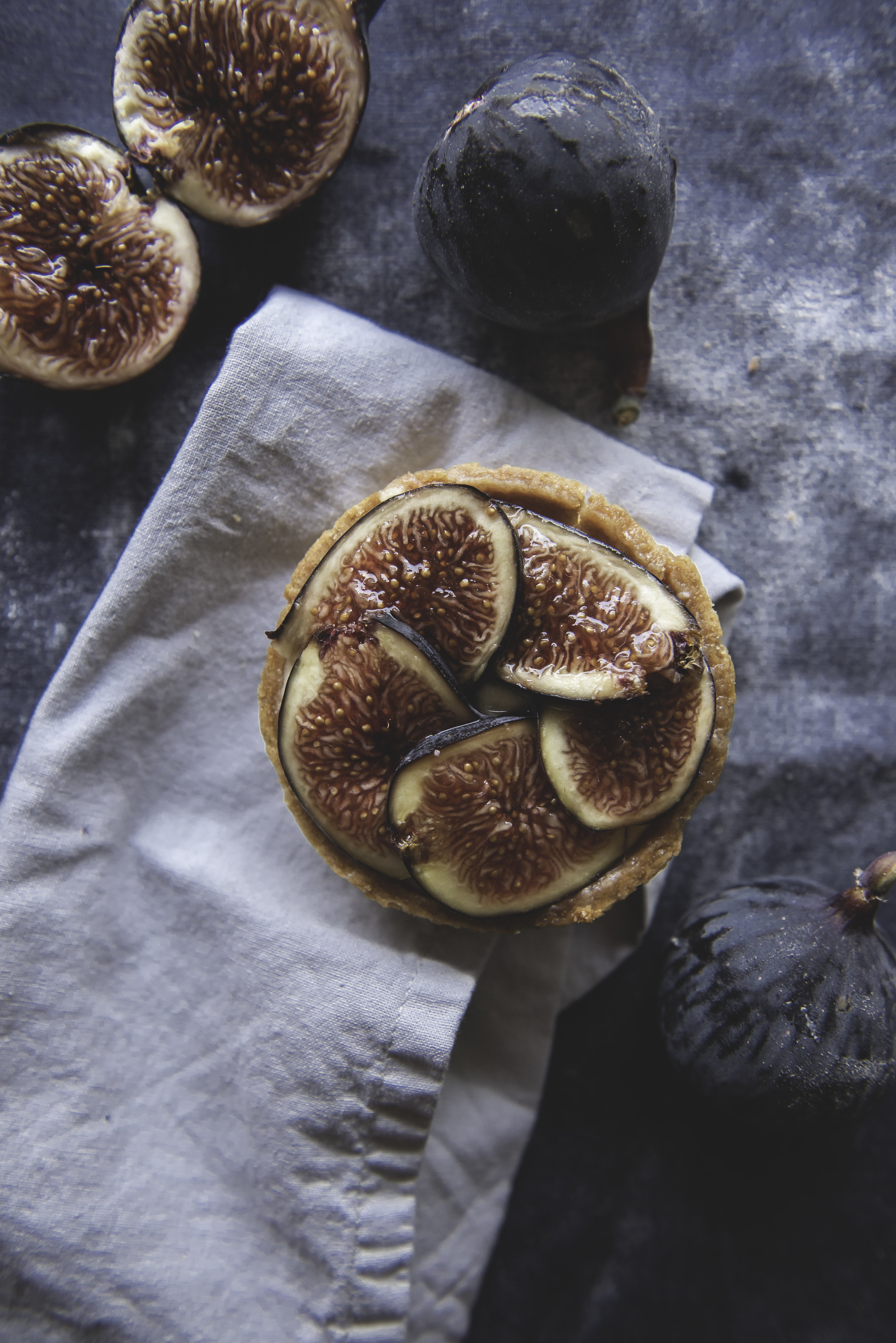 Fig & Goat Cheese Tart - Subtle fresh figs sit atop a honey-goat cheese custard and a traditional sucre pastry shell.