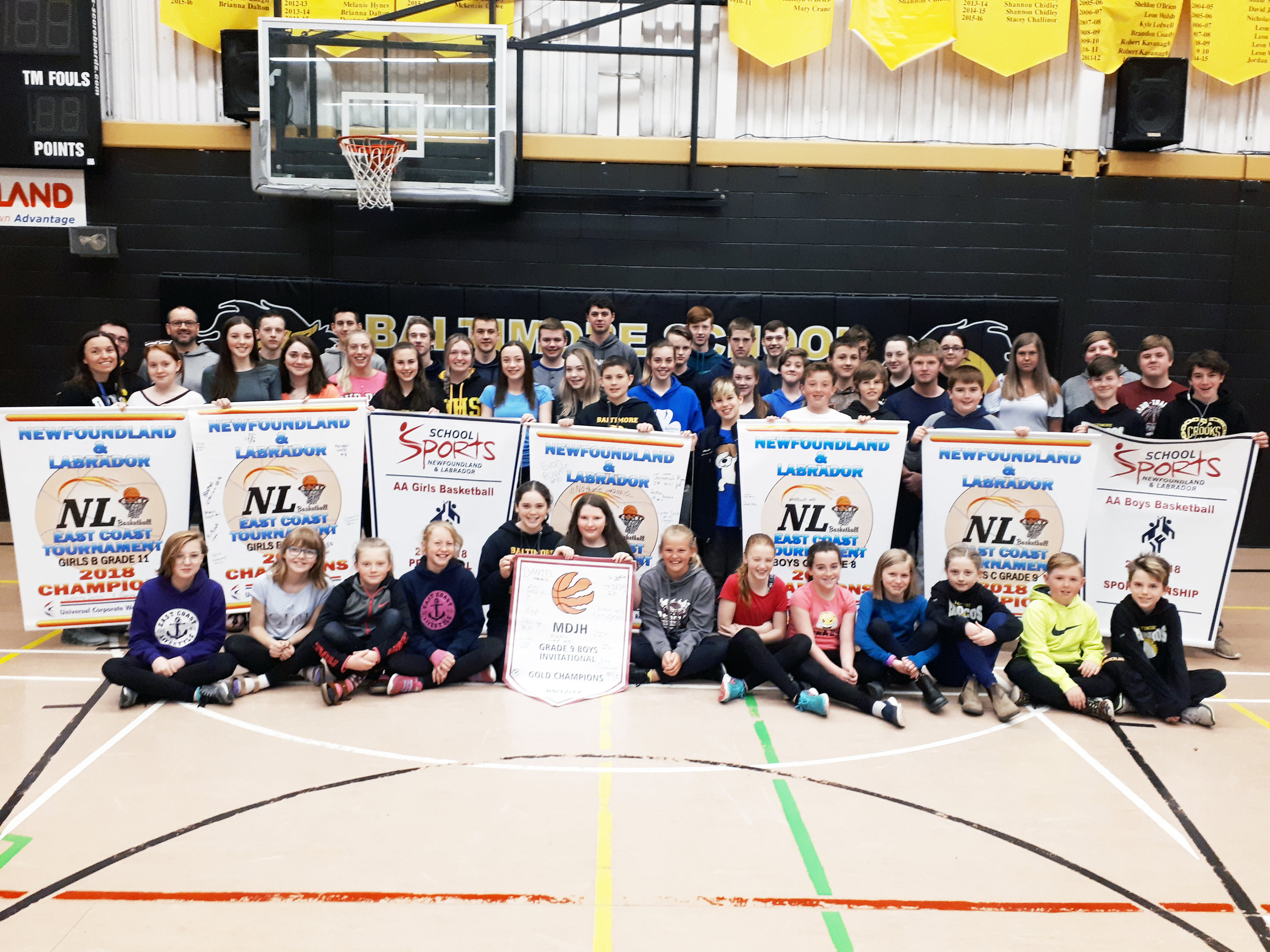 Students at Baltimore School in Ferryland gathered recently for a group photo with all the provincial basketball banners they capturred this past season.