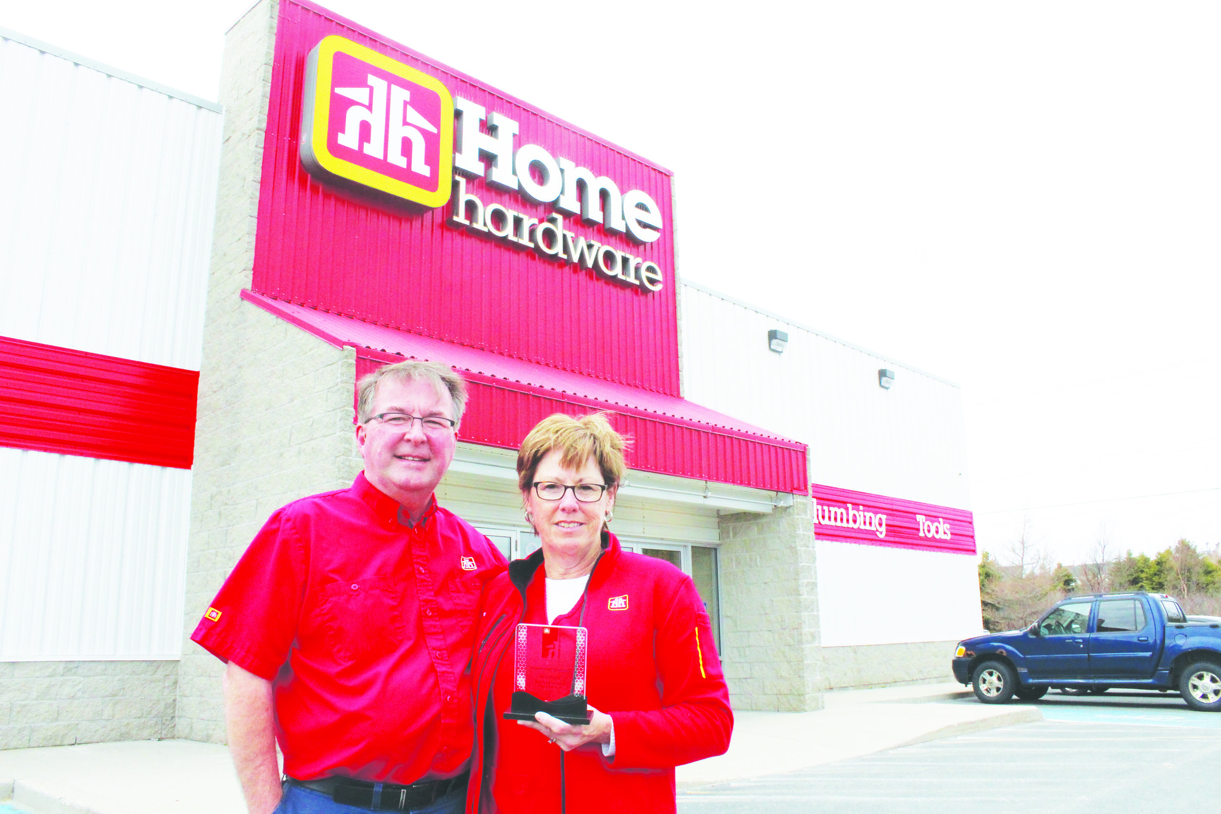 Dan and Kim McDonald outside their Home Hardware store in the Goulds. Their operation was recently deemed among the top stores in the national chain.  Mark Squibb photo