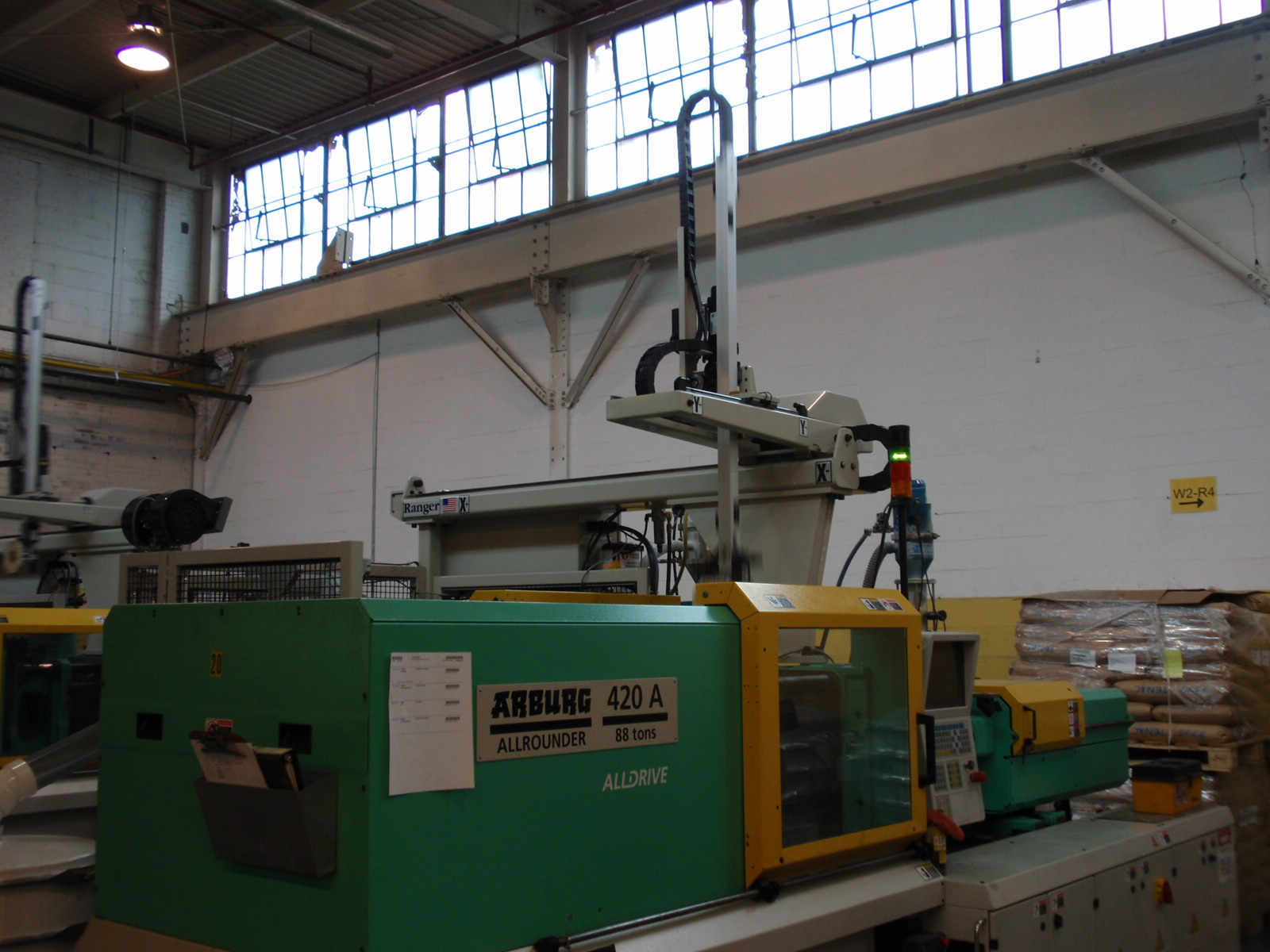 RT-100S3 Robot on Arburg Machine.JPG