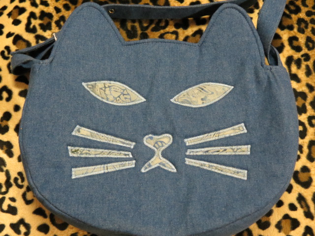 Locally-crafted purses, wallets, bags