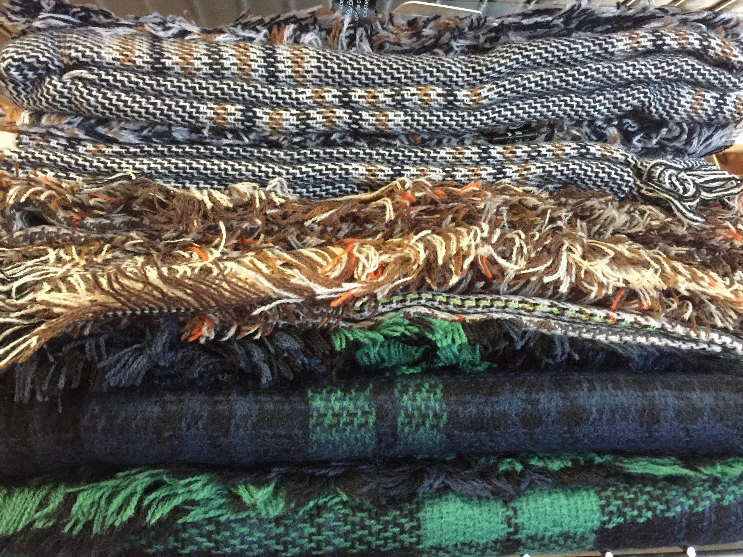Just a sample of some of our current selection of blanket scarves!
