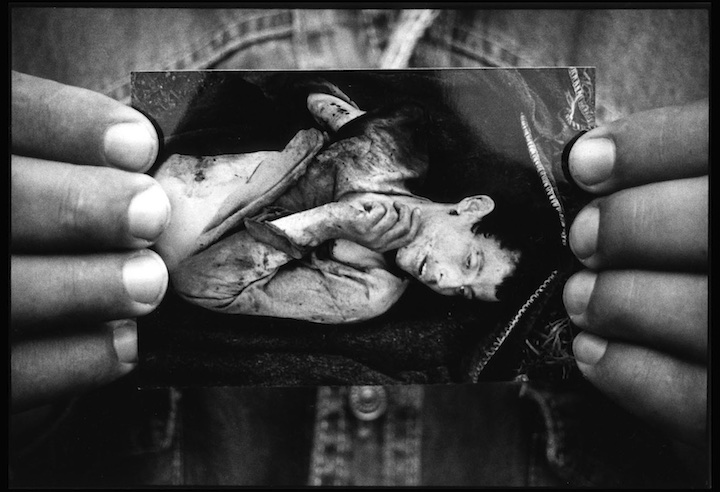 Habib Zogaj of Turjak holds a photograph he took of 16 year old Mehdi Krasniqi who he says was executed by Serb soldiers on the 31st of March 1999.