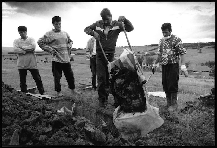 In the village of Cara Luka the uncle of 13 boys and 9 girls from the Krasniqi family shot and burned in their home by Serb military forces collects their remains in a wheel barrow for reburial. The oldest child was 19 years old.