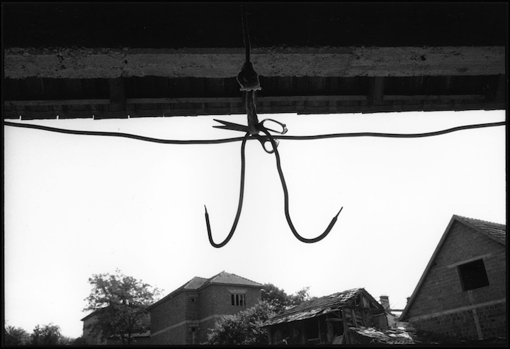 Meat hook hanging from a farm in Velika Krusha where many civilians were executed. Under the hook I found a lot of pornographic magazines.