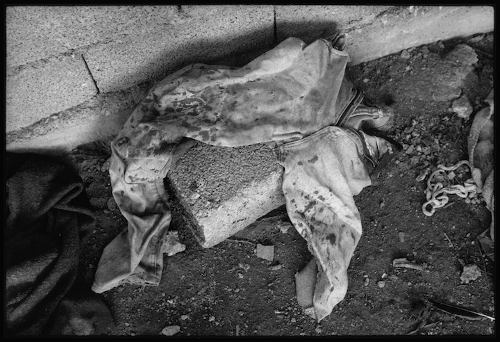 I was taken to this roadside shack by some Kosovo Liberation Army soldiers who were trying to locate a mass grave for me. Outside the shack were the torso and legs of a girl. The girl had been raped inside the shack. There was a significant amount of blood in the area of her genitals and a meat hook suspended from the ceiling. Their was blood stained bedding on the floor. In the area next to the body was evidence of a fire and canned food where someone had enjoyed lunch. Many refugees reported that young women were dragged from vehicles and raped by the side of the road by Serb military and paramilitary forces.