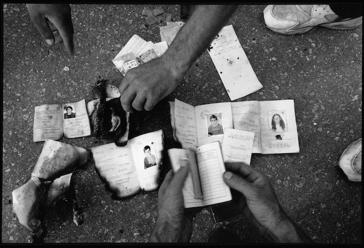 Identity documents of people presumed murdered next to a mass grave near Meja, Kosovo.