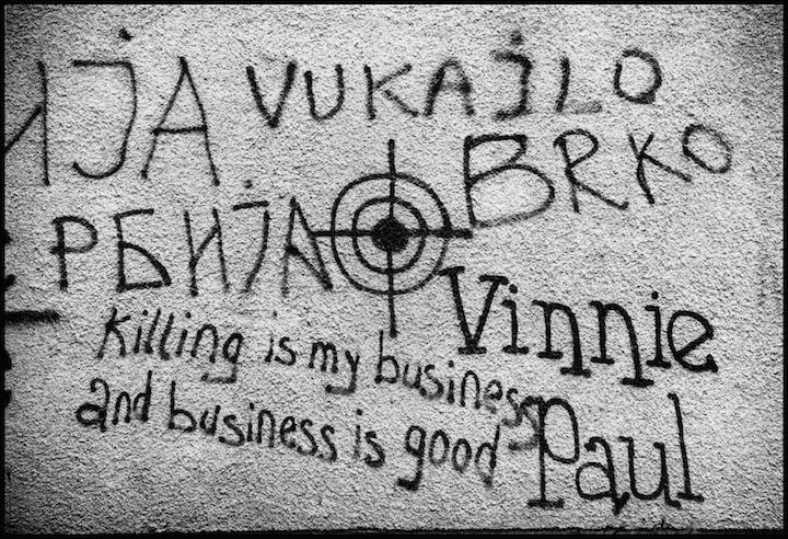 Graffiti on a roadside wall between Prizren and Pristina.