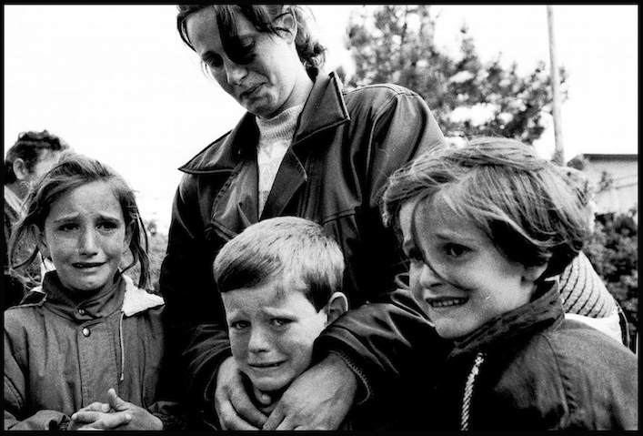 Kosovar children who had just crossed the border into Albania having witnessed the murder of their father a few hours earlier in the village of Meja.