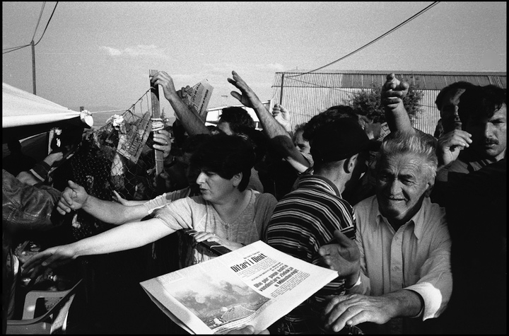 Refugees clamour for the morning edition of the Kosovar newspaper  Koha Dittore  which was printed in exile in Stankovic refugee camp, Macedonia.