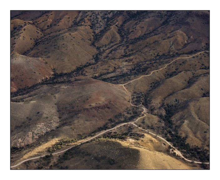 A solitary United States Border Patrol vehicle in the Baboquivari Mountains, Southern Arizona.