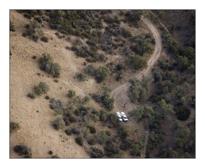 Two United States Border Patrol vehicles parked on a trail in the Atascosa Mountains in the Coronado National Forest, Southern Arizona.