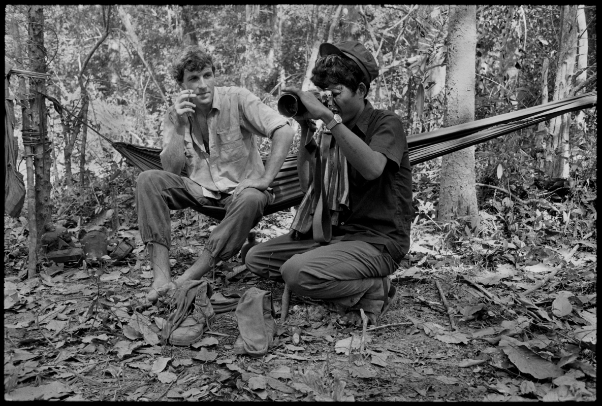 Thierry shows the Khmer Rouge how to use his Nikon. Cambodia. 1991