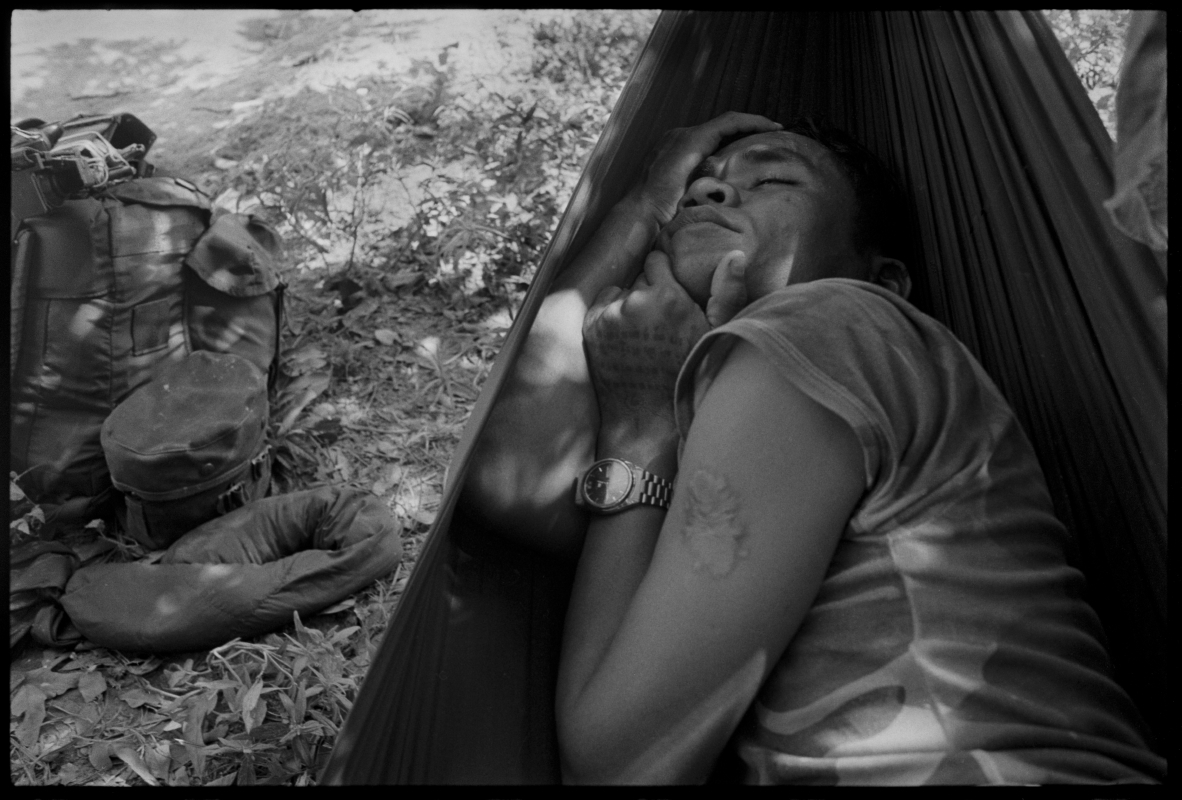 KPNLF soldier sleeps after a 40 km march during a long range 6 week mission, Cambodia, 1991