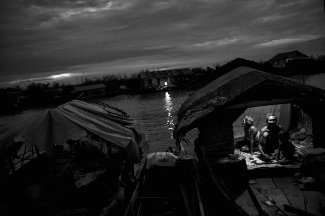 Residents of a floating village, Siem Reap, Cambodia. Photograph by Maciek Nabrdalik of VII Photo Agency who was a workshop student of Gary and Philip in 2009.