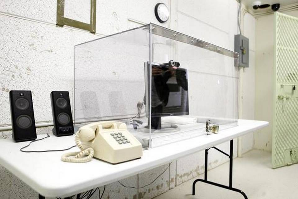 This image shows the video monitoring screen used for video-teleconference calls between members of the general detainee population at Guantanamo and their families. Copyright: A Nelson/ICRC
