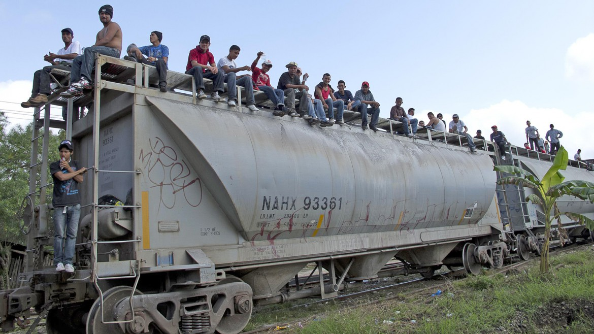 Migrants from Central America wait for a train to leave. Hundreds of thousands of migrants from Central America risk their lives every year in search of a better life in the United States.