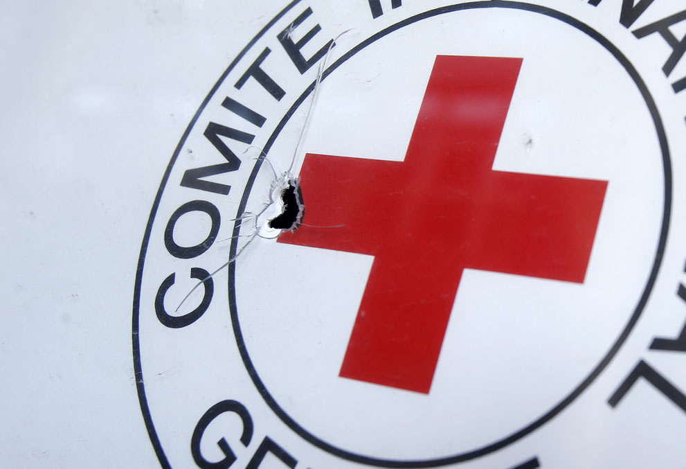 A bullet hole in a Red Cross sign, outside an office in the town of Donetsk on October 3, 2014. A Red Cross staffer died when a shell landed near the group's office in Donetsk. (AP Photo/Darko Vojinovic) Courtesy of The Atlantic