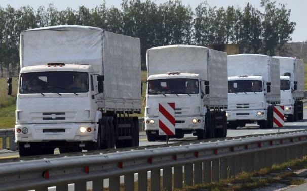 A Russian convoy of trucks carrying humanitarian aid for Ukraine drives along a road near the city of Yelets August 12, 2014. CREDIT: REUTERS/NIKITA PAUKOV