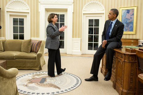 """Statements by top presidential advisors, like Lisa Monaco, pictured here briefing President Obama in the Oval Office, have become """"go-to sources"""" for analyzing how the US interprets IHL, says Professor Blank. (Official White House Photo by Pete Souza.)"""