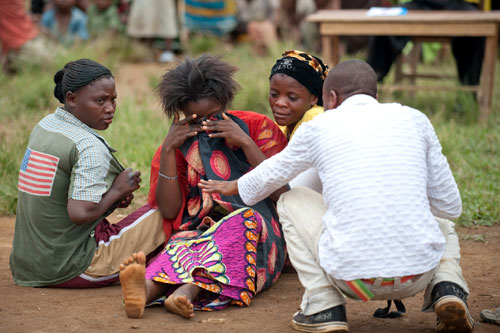 Villagers in Bunyakiri, DRC, perform a play about a woman who has been raped. Such dramatizations help sensitize communities to victims' suffering. © ICRC / P. Yazdi