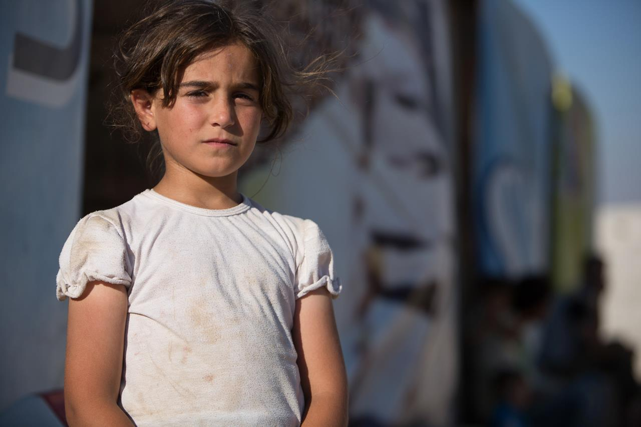 The future looks uncertain for this little girl from Deraa, who, along with her family, fled the war in Syria recently. She shares a tent with eight family members in an informal refugee settlement in Lebanon's Bekaa Valley. © ICRC / J. Spaull