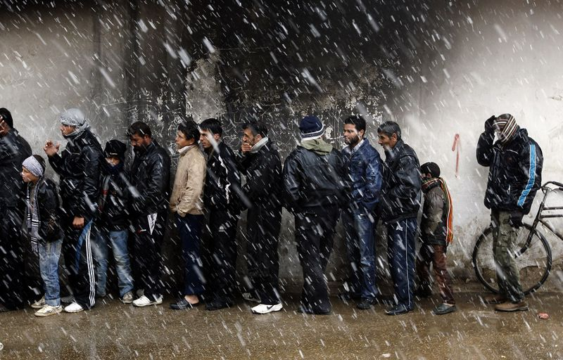 Growing needs outside of Baba Amr - Waiting to buy bread, Al Qusayr, near Homs - Photo courtesy of Reuters/Goran Tomasevic