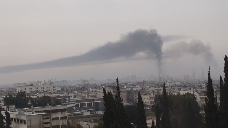 Exceptional measures needed to reach Syrian victims - Homs under fire - Photo courtesy of Reuters/Handou
