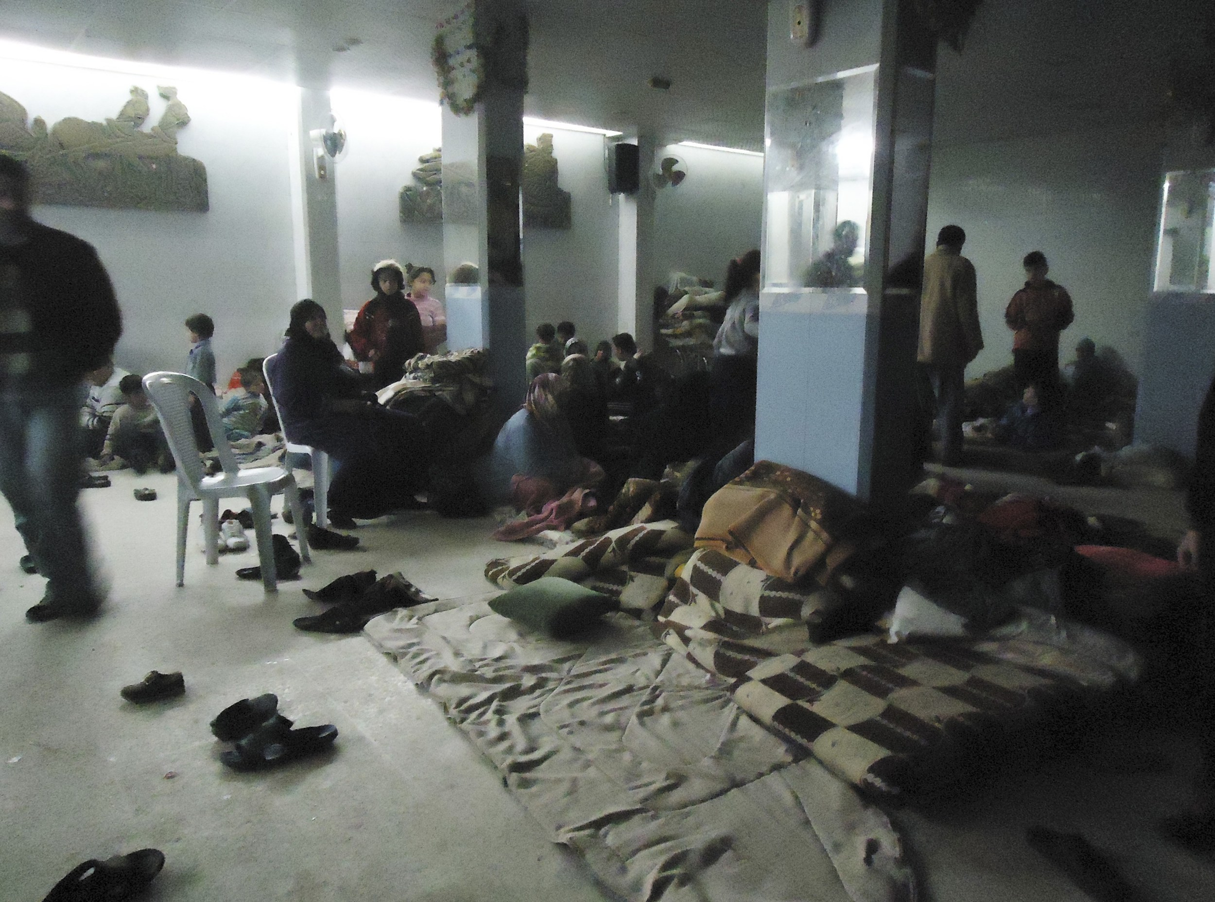 Syrian civilians bear brunt of violence - Shelter in Baba Amro, near Homs Photo courtesy of Reuters/Mulham Alnader