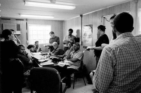 A visiting team discusses a day's work at our Guantanamo office.