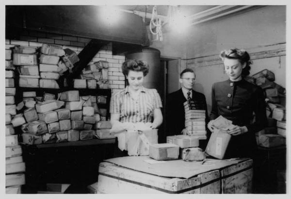 Unpacking books sent by the German Red Cross for distribution in POW camps