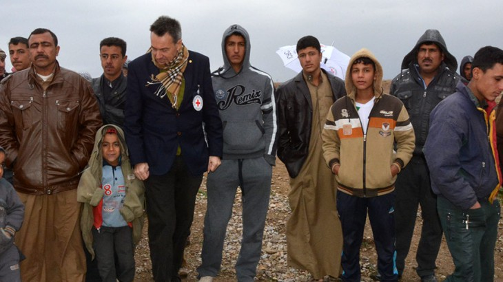 """During a January 2015 visit, Mr. Maurer (pictured wearing an ICRC badge) said he heard """"heartbreaking stories"""" from people displaced by fighting in Iraq. Copyright: ICRC / S. Dabbakeh"""