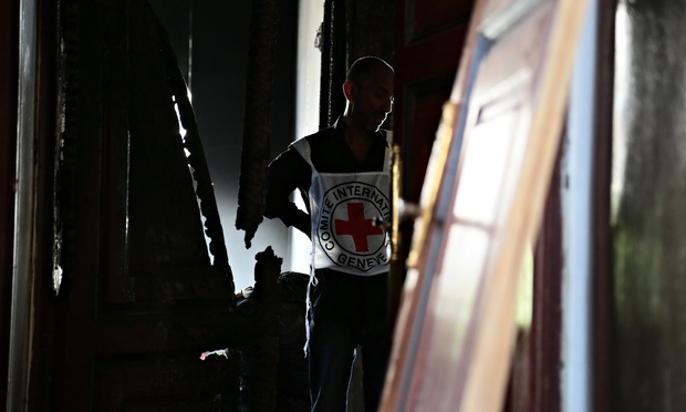 A Red Cross worker in a bomb damaged building in Faj Attan, Sana'a, Yemen. Photograph: Thomas Glass/ICRC