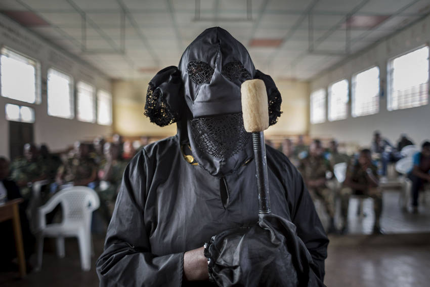Democratic Republic of the Congo - A victim, veiled to protect her identity, testifies in court. On a November evening in 2012, FARDC soldiers pillage her home and raped her. When her husband learned she had been raped, he l eft. He never returned.