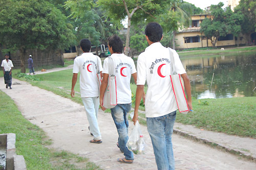 Bangladesh Red Crescent Society volunteers raise awareness about the emblem