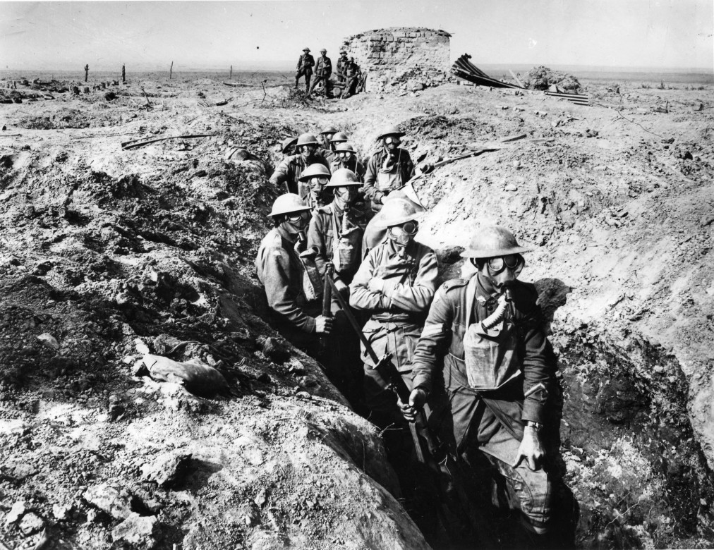Ypres, Belgium, 1917. Australian soldiers wear masks to protect themselves from poison gas. Chemical weapons were widely used during the First World War, causing death or terrible injuries. The 1925 Geneva Protocol prohibited the use of asphyxiating and poisonous gases in war.© Imperial War Museum London / hist-00687-01
