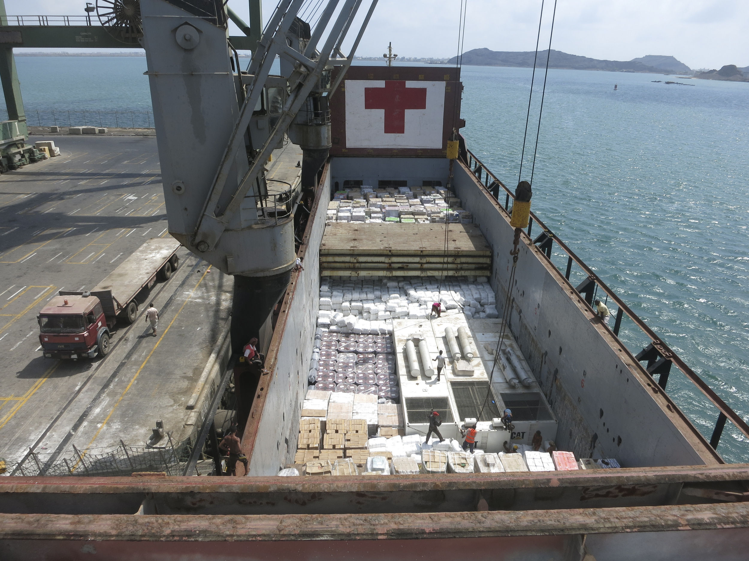 Aden port. three 1.5 MW generators arrive on an icrc cargo ship along with other assistance items.  these generators will provide 36% of the water consumed in Aden. Mohammed BANAFEA,/ ICRC.