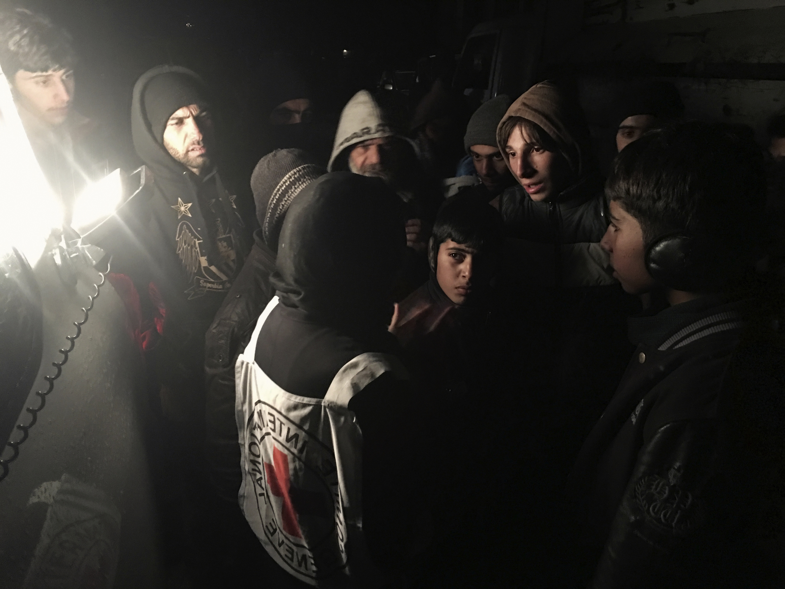 JANUARY, 2016, MADAYA.  ICRC's HEAD OF DELEGATION IN SYRIA, MARIANNE GASSER, SPEAKS TO RESIDENTS AS THEY GATHEREr AROUND AN AID CONVOY. © ICRC/ pawel KRZYSIEK.