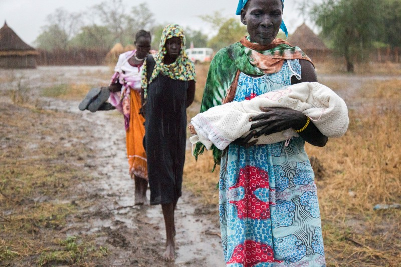 Nyamuoch, centre, and her relatives carry Nyanene's body back to their village.