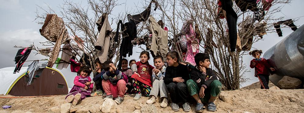 Yezidi children seen at a small IDP camp near Snyuy, an Iraqi city at the base of Mount Sinjar. (Sebastian Backhaus/NurPhoto via Getty Images)